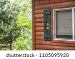 cabin window shutters green... | Shutterstock . vector #1105095920