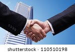 handshake on  background of skyscraper - stock photo