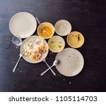 the remains of food in plates ... | Shutterstock . vector #1105114703