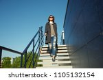 outdoor portrait of a stylish... | Shutterstock . vector #1105132154