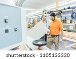 carpenter in furniture factory... | Shutterstock . vector #1105133330