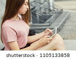 school girl using a tablet... | Shutterstock . vector #1105133858