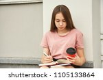 girl writing pen in notebook.... | Shutterstock . vector #1105133864