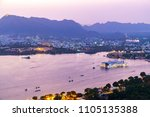 udaipur city at lake pichola in ... | Shutterstock . vector #1105135388