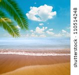 Tropical sea and beach with palm leaves - stock photo