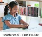 asain kid using laptop in... | Shutterstock . vector #1105148630