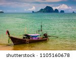 traditional long tail boat at... | Shutterstock . vector #1105160678
