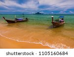 traditional long tail boat at... | Shutterstock . vector #1105160684