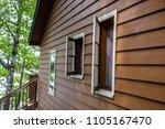 cabin up north windows porch...   Shutterstock . vector #1105167470