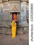 Small photo of Bhimashankar Temple / India 29 May 2018 Devotee offering their prayers to a statue of Lord Hanuman at Behind The Bhimashankar temple in Bhimashankar Maharashtra India