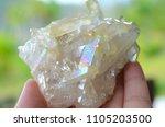 white angle aura quartz cluster ...   Shutterstock . vector #1105203500