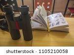 binoculars with bird guide | Shutterstock . vector #1105210058