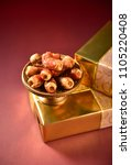 bowl of dates placed on top of... | Shutterstock . vector #1105220408