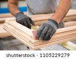 man who is sanding a window... | Shutterstock . vector #1105229279