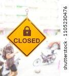 closed sign in shop window | Shutterstock . vector #1105230476