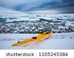Kayak In Frozen Arctic Ocean