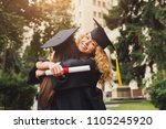 pair of students hugging on... | Shutterstock . vector #1105245920