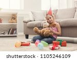 happy little girl in party hat... | Shutterstock . vector #1105246109