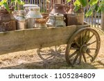 Old Carriage With Milk Churns...