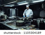 chef preparing a meal in the... | Shutterstock . vector #1105304189