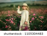 cute child girl is holding... | Shutterstock . vector #1105304483