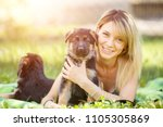 young smiling woman lying on... | Shutterstock . vector #1105305869