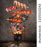 kettle grill with hot... | Shutterstock . vector #1105310243