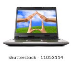 Conceptual Home symbol on a laptop computer display Real Estate Environmental technology concept - stock photo
