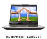 Conceptual Home symbol on a laptop computer display Real Estate Environmental technology concept - stock photo
