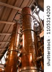 copper columns stand tall to... | Shutterstock . vector #1105314200