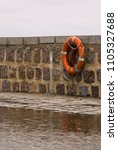 life saver ring on the sea wall | Shutterstock . vector #1105327688