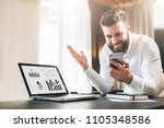 young bearded businessman in a... | Shutterstock . vector #1105348586