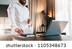 young bearded businessman in... | Shutterstock . vector #1105348673