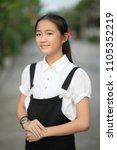 asian teenager wearing black... | Shutterstock . vector #1105352219