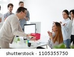 excited male worker... | Shutterstock . vector #1105355750