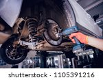 cleaning disc brake on car  in... | Shutterstock . vector #1105391216