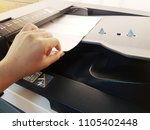 a hand is holding a paper to... | Shutterstock . vector #1105402448