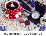 cup of flower tea with runes ... | Shutterstock . vector #1105436423