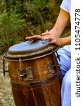 Small photo of Woman percussionist hands playing a drum called atabaque during brazilian folk music performance