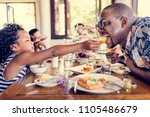 guests having breakfast at... | Shutterstock . vector #1105486679