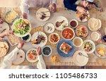 muslim family having a ramadan... | Shutterstock . vector #1105486733