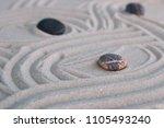 pyramids of gray zen stones on... | Shutterstock . vector #1105493240