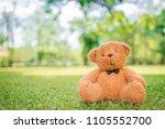 bear doll sitting on green...