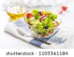 spring vegetable salad with... | Shutterstock . vector #1105561184