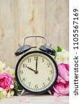 alarm clock 10 hours. flowers.... | Shutterstock . vector #1105567169