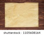 yellowed pages of old paper on...   Shutterstock . vector #1105608164
