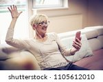 senior woman at home relaxing... | Shutterstock . vector #1105612010