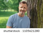 casual middle aged man leaning... | Shutterstock . vector #1105621280