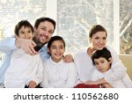 Happy family with kids on the couch - stock photo
