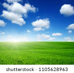 green field  blue sky and sun.  | Shutterstock . vector #1105628963